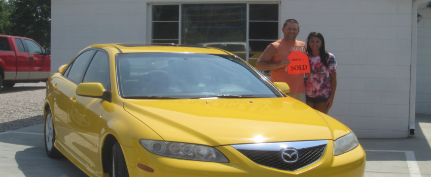 yellow mazda couple